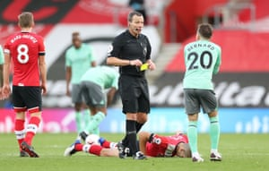 Bernard is shown a yellow card by referee Kevin Friend.