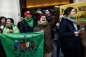Via Campesina activists gather in front of the headquarters of French food and drink company Danone