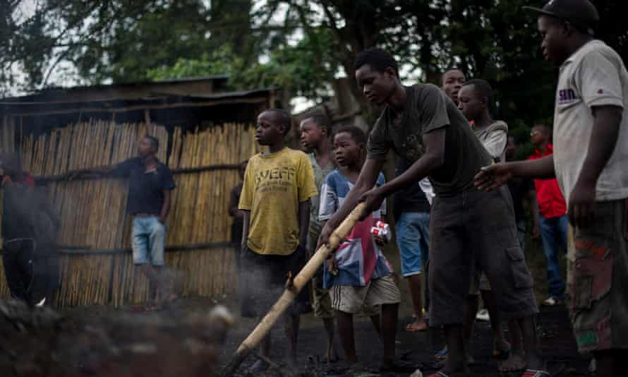 Children stand next to a burning barricade during protests against a third mandate for incumbent president Pierre Nkurunziza in Bujumbura, Burundi, on 5 May.