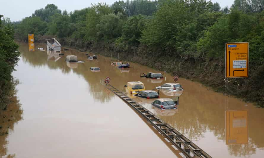 Abandoned vehicles on flooded highway 265 after a landslide caused by a major flood near Erftstad.