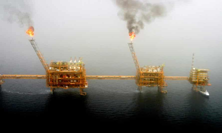Gas flares from an oil production platform are seen at the Soroush oil fields in the Persian Gulf.