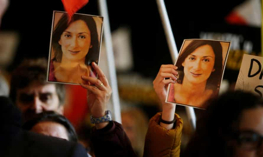 People carry pictures of the assassinated journalist Daphne Caruana Galizia at an anti-corruption protest in Valletta, Malta, on Saturday.