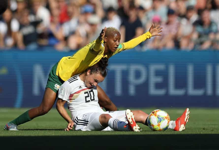 Lina Magull of Germany is challenged by Busisiwe Ndimeni of South Africa during a group B match between South Africa and Germany at Stade de la Mosson.