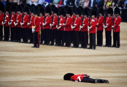 A Guardsman faints at Horseguards Parade for the annual Trooping the Colour ceremony