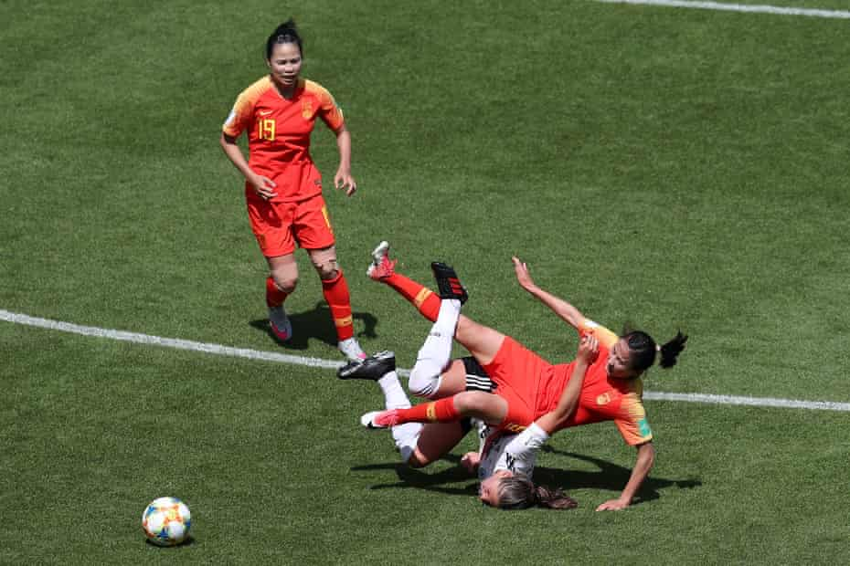 Li Yang of China clashes with Melanie Leupolz of Germany during a group B match between Germany and China PR at Roazhon Park.