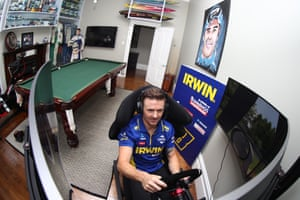 Mark Winterbottom, supercar driver for Irwin Racing, trains on a simulator at home in Melbourne.