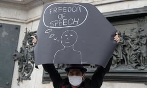 A demonstrator holds a placard in Paris backing free speech