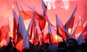 Polish nationalists carry Polish national flags as they take part in the March of Independence in 2017.