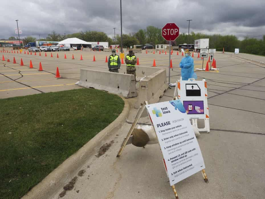 A healthcare worker waits for people to show up to a testing site in Sioux City.