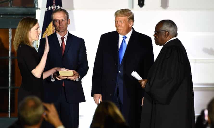 Amy Coney Barrett is sworn in as supreme court justice, the most recent of more than 200 conservative judicial appointments by Donald Trump.