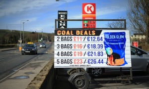 Fluid flow: A sign displays the price of coal in both GB Sterling and Euro at a petrol station in Strabane.