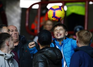A young Terriers fan heads the match ball back to the pitch as Huddersfield draw 1-1 with West Ham at The John Smith's Stadium.