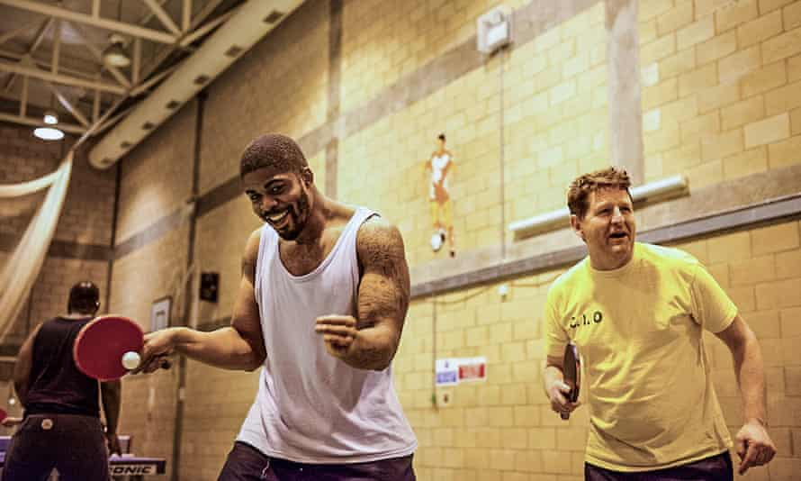 A ping-pong game at High Down prison, where violent behaviour has fallen by 83% among attendees.