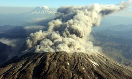 Mount St Helens erupts with steam, dust and ash 5 October 2004, in this photograph taken at 12,000 feet looking north. In the background is Mount Rainier.