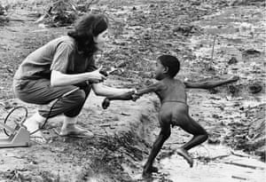 A nurse from British charity War on Want attempts to vaccinate a terrified boy against cholera during an outbreak of the disease at a refugee camp outside Kolkata during the Bangladesh Liberation War, June 1971.