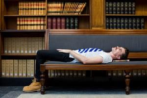 Nic Holas lying on a chair