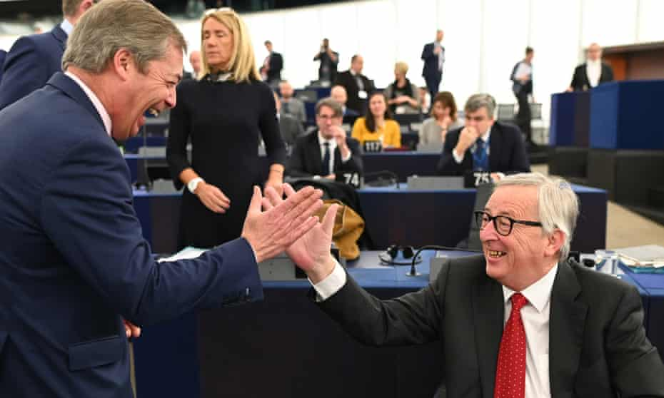 Nigel Farage (left), the former leader of the UK Independence party (Ukip) jokes with the president of the European commission, Jean-Claude Juncker.