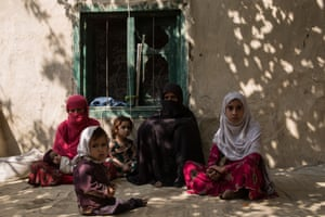 Group of women sit outside in the shade