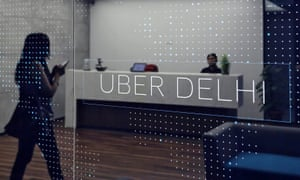 An employee walks inside the office of ride-hailing service Uber in Gurugram, on the outskirts of New Delhi