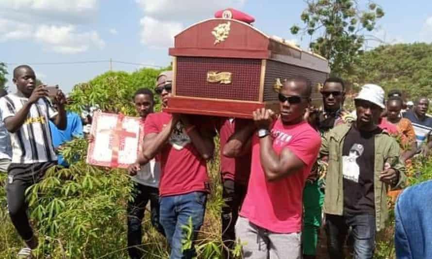 People carrying Daniel Apedel's coffin