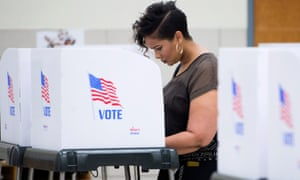 A voter fills out her ballot.