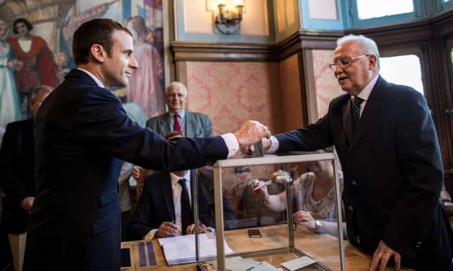 Emmanuel Macron casts his ballot in Le Touquet, northern France.
