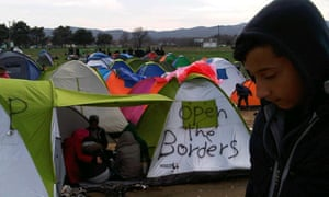 A Syrian refugee in front of a tent in Idomeni.