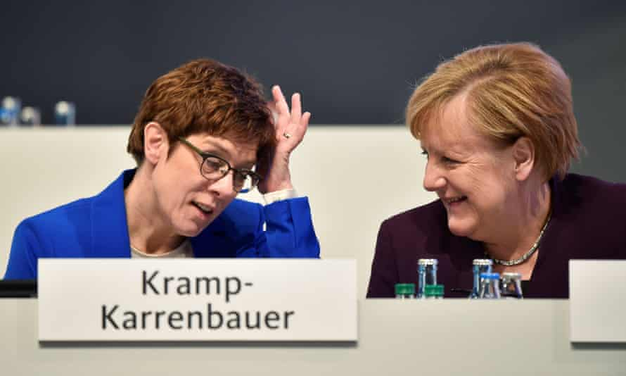 Kramp-Karrenbauer with Merkel at the conference.