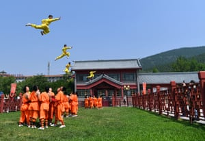 Performers stage a martial arts performance on Mount Song in China