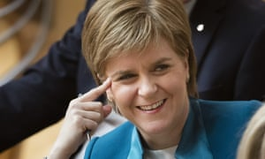 Nicola Sturgeon listens to proceedings in the Scottish parliament after being reappointed first minister.