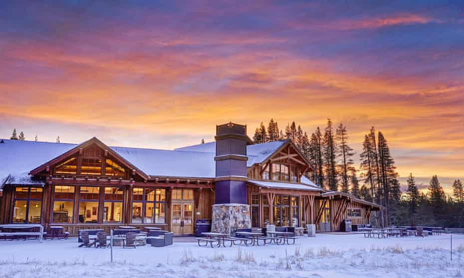 Bathed in a rich, orange and blue sunset, the adventure centre at Tahoe Donner, California.