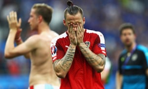 Whilst Austria's Marko Arnautovic is dejected.