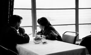 'The waiter did not come, the clock / forgot them' ... a young couple sit by the window of a cafe.