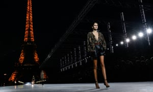 Dry ice and sparkles … Kaia Gerber walks in the Saint Laurent show.