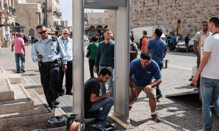 Police install a metal detector at the Jaffa gate for security screening at an entrance to the old city in Jerusalem.