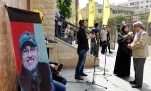 Lebanese press outside building where family members of Mustafa Badreddine had gathered in Beirut