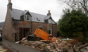Flood damaged furniture lies outside a house in Ballater, Aberdeenshire