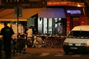 Forensic police search for evidences outside the La Belle Equipe restaurant.