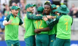 Kagiso Rabada of South Africa (third right) is congratulated by his teammates after he caught and bowled Colin Munro of New Zealand.
