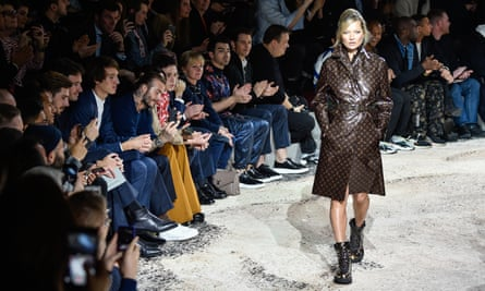 Kate Moss strides out on the catwalk for the Louis Vuitton Menswear A/W 18-19 show at Paris fashion week