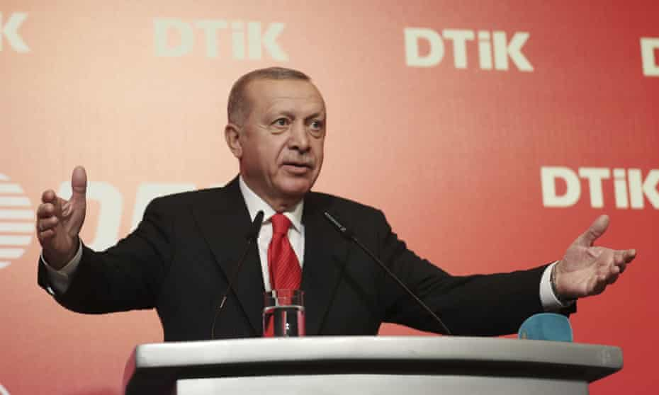 """Turkey's President Recep Tayyip Erdoğan addresses the World Turkish Business Council meeting, in Baku, Azerbaijan, Monday. Oct. 14, 2019. Erdogan says Turkey's military offensive into northeast Syria is as """"vital"""" to Turkey as its 1974 military intervention in Cyprus, which split the island in two. (Presidential Press Service via AP, Pool)"""