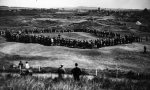 Crowds watch Macdonald Smith playing in the final Open to be played at the old Prestwick course, in 1925.