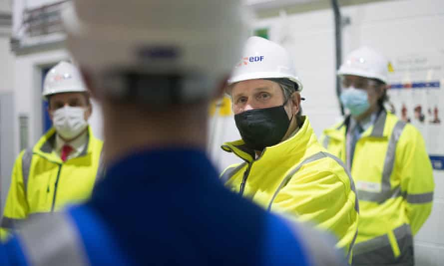 Keir Starmer, centre, campaigning in Hartlepool with the party's by-election candidate, Paul Williams, at EDF in high-vis jacket and hard hat