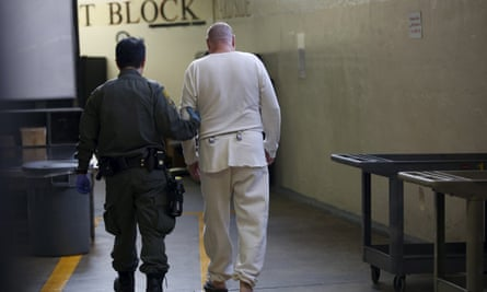 A guard escorts a condemned inmate at California's death row at San Quentin State Prison. Though 30 states still have the death penalty, only a handful still issue death sentences.