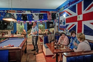 British tourists play pool at a bar in Benalmádena, Spain