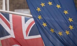 A Union Jack and the EU flag.