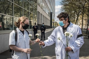 French healthcare workers lay flowers in front of the health ministry as they gather to pay tribute to medical interns who committed suicide during the Covid-19 pandemic in Paris, France. According to the National Union of medical interns, an intern has committed suicide every 18 days since January 2021 due to the working conditions amid the Covid-19 crisis.