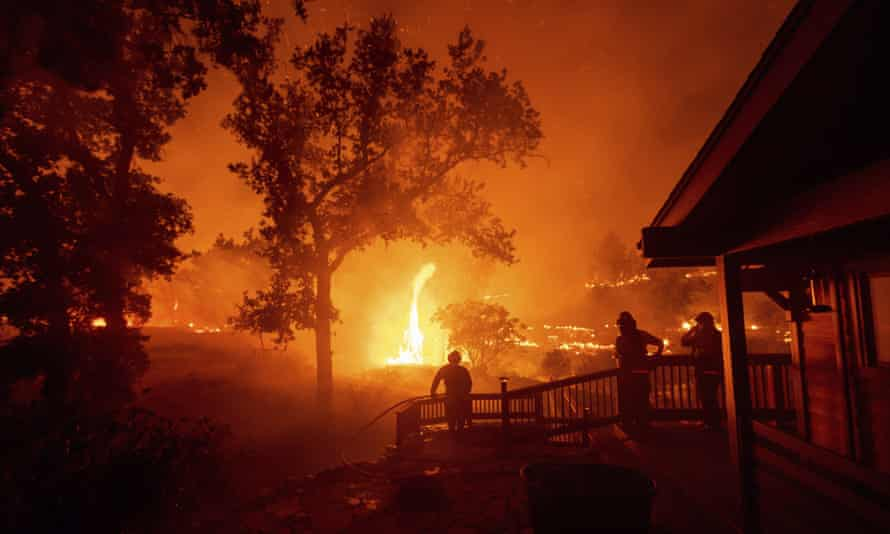 Firefighters encounter a wildfire, the fifth largest in California history, in Napa county California on 21 August 2020.