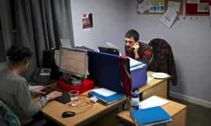 The small StreetLink team taking calls during their night shift.