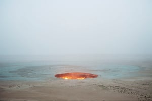 Carolyn Drake: Darvaza. Turkmenistan, 2009. Buy this printCarolyn Drake writes: 'The enigmatic qualities of photography are a continuing obsession. The site is locally known as the Door to Hell. The 69-meter-wide crater has been burning natural gas since 1971 when Soviet petroleum engineers, concerned about contaminating the air after an excavating accident, tried to burn off the remaining gas by lighting it. The picture doesn't show any of this, though. The scale of time and space remain a puzzle in the image, pointing to the difficulty of perceiving the scope of human impact on the planet.'